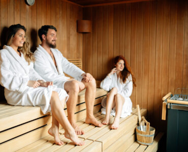People in sauna relaxing and staying healthy